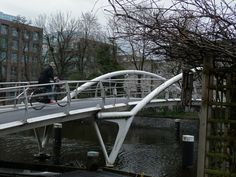 Foot & bicycle bridge with trees and branches in winter Amsterdam city photo in 2013 by Amsterdam city photos geotagged by archiref / Collect visual inspiration on http://www.openbricks.io