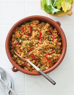 Spanish rice with chicken, peas and lemon recipe : SBS Food How To Cook Zucchini, How To Cook Rice, Chicken And Spanish Rice, Marinated Chicken, Diced Chicken, Chicken Rice, Sbs Food, Lemon Recipes, Savoury Recipes