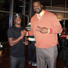 shareece wright lookin small standing next to this guy