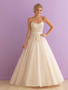 Allure Romance 2908. This ballgown is topped by a strapless lace bodice, shaped by a simple satin waistband.