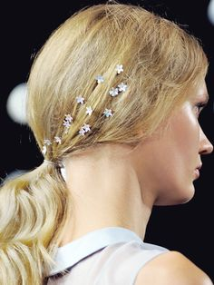 abigaildonaldson:  Models at Honor Spring/Summer 2014 wore tiny iridescent flowers sprinkled in their hair.