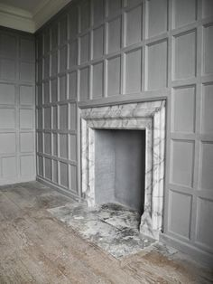 "From the design blog: Belgian Pearls--- ""Tudor interiors were typically heavily paneled. This room is been given a softer look by painting the panelling, which is the perfect backdrop for contemporary designed furniture."" Photo source unknown."