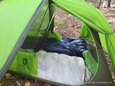 While the tent width is snug, there's plenty of extra room at the head end of the tent along with large side pockets for each occupants. I speak from experience.