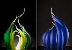 "Florida-based sculptor Rick Eggert produces glass works that are often displayed as groups, each individual sculpture adding to a collective warm or cool gradient. Classified on his website as ""Waves,"" ""Flames,"" and ""Dew Drops,"" the glass-blown pieces all seem to gravitate toward natural elements, s"