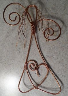 Copper Wire Art Angel Rustic Angel Hammered Metal Angel. $28.25, via Etsy.