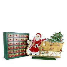 "Villeroy & Boch Santa's Sleigh Advent Calendar PRICE: $500.00 Bring a classic touch of holiday charm to your home with this Villeroy & Boch advent calendar. Each wooden drawer contains an ornament to be placed on Santa's porcelain sleigh, letting you mark the days until Chirstmas with festive appeal. Calendar: 18""H x 14.5""W x 5.75""D; Sleigh: 12.5""H x 12.5""W x 3.75""D Porcelain/wood"