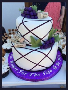 Grapes / Wine Theme Bridal Shower Cake with corks from the vineyard party location.  Sugar grapes and sugar leaves.  Tastefully Wright, LLC www.nhweddingcakes.com