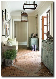 chic hallway with brick tiled floor... leading to the garden #naturalcurtaincompany