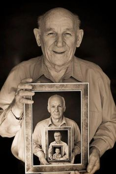 A wonderful photo idea for the generations!  Would be neat on two levels - The same man, holding his photos through the ages, or with a great-grandfather, grandfather, father and son.