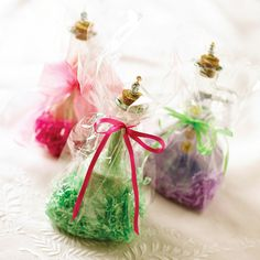 Handmade Bath Gifts  To show off bath salts in pretty glass containers, cut a square of cellophane, lay it flat, and sprinkle cut strips of crinkled paper in the middle. Set the bottle in the center of the cellophane and gather the sides. Tie a colored ribbon around the bottle's neck. Get instructions for bath salts.