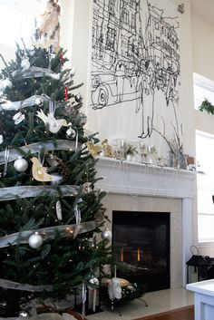 modern simple Christmas tree and the fire place mantel gets a focal point with the Marimekko fabric.