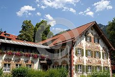 Photo made in Oberammergau in Germany. The picture shows one of the typical houses of the country where almost all the houses are painted and some with scenes depicting fairy tales or other stories. In addition to paintings that surround the windows, the white fixtures, stand out the flowers that adorn the left.