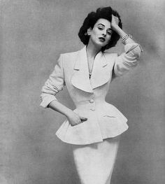 Dorian Leigh wears a peplum suit in the 40's...trending again now.