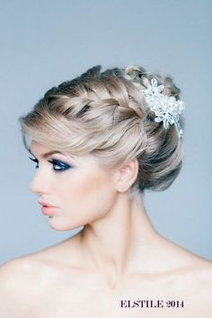 A bold braid paired with a wedding headpiece looks