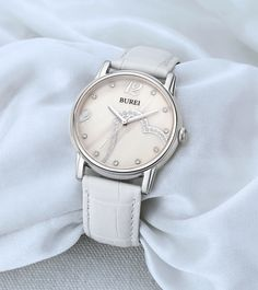BUREI® Women's BL-3023-01A White Mother-Of-Pearl Dress Watch with White Leather Band Price:$35.00