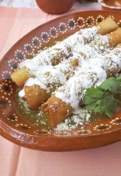 Flautas Ahogadas (Crispy Flautas in Salsa) - Hispanic Kitchen : Hispanic Kitchen Mexican Cooking, Mexican Food Recipes, Dinner Recipes, Mexican Appetizers, Yummy Recipes, Good Food, Yummy Food, Tasty, Yummy Yummy