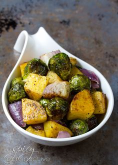 Oven Roasted Brussels Sprouts and Butternut Squash | ASpicyPerspective.com #vegan #glutenfree #recipes