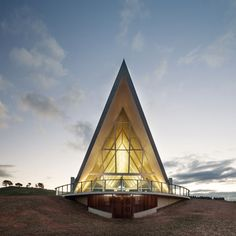 A pavilion with an arching roof by Tonkin Zulaikha Greer Architects rises above the new National Arboretum on the outskirts of Canberra, Australia.