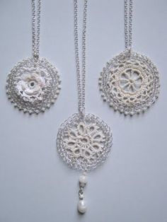 These are just beautiful.  It looks like a mixture of crochet thread and wire, plus beads.