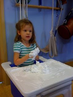 Kid playing w/ shaving cream during an OT session.