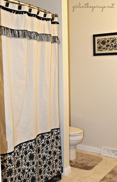 Finished bathroom makeover with DIY custom curtain.  Girl in the Garage