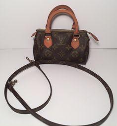 6b3712d0563 Louis Vuitton Speedy Mini With Monogram Strap Brown Monogram Cross Body Bag.  Get the trendiest