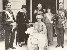 Queen Marie of Romania holding her grandson,Peter at his christening in her is King Ferdinand of Romania.To the right are the Duke and Duchess of York.To her left are the King and Queen of Yugoslavia. Queen Elizabeth Father, Queen Mother, Queen Mary, Duchess Of York, Duke Of York, Duke And Duchess, Royal Crowns, Royal Jewels, Von Hohenzollern