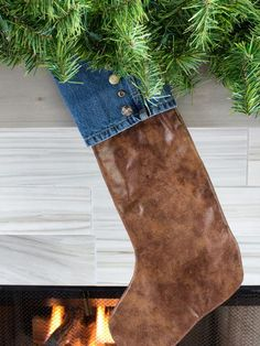 Denim + Leather Stockings - 10 Rustic-Chic Holiday Decorating Ideas on HGTV