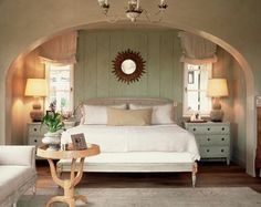 Recreate this by adding a faux arched wall...I'd come out to end of the bed to create a cozier area...
