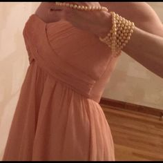 """J CREW strapless peach dress Elegant!  Beautiful lined light peach dress from J CREW with gathering, Ruching and empire waist - see with mid back zipper. 29"""" length from top of back zip to hem. Bust 16.5"""" at top. Gorgeous!  . Outer layer SILK.  Bodice lining cotton    Skirt lining polyester J. Crew Dresses Strapless"""