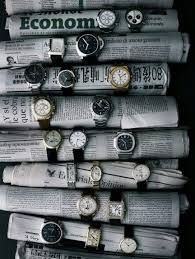 clever way to display watches, around rolls of newspaper