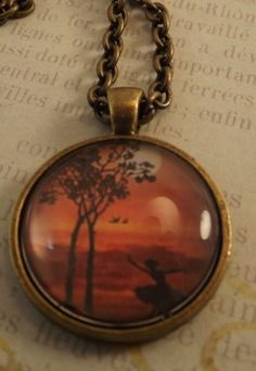 'Dancing at Sunset Pendant Necklace' is going up for auction at 12pm Sat, Sep 1 with a starting bid of $7.