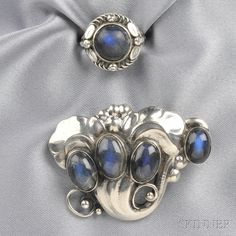 Georg Jensen silver and labradorite brooch, depicting bud and foliate motifs, design #105, and similar ring, design #1.