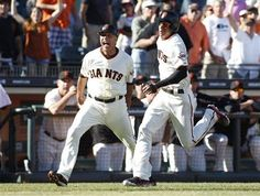 San Francisco Giants' Ehire Adrianza, right, runs towards the plate as third base coach Tim Flannery yells during the 11th inning of a baseball game against the Arizona Diamondbacks, Sunday, Sept. 8, 2013, in San Francisco. The Giants defeated the Diamondbacks 3-2 in 11 innings. (AP Photo/George Nikitin)