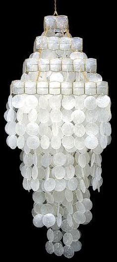 Crazy for Capiz Shell light fixtures...see more!
