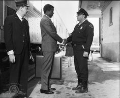 Still of Sidney Poitier and Rod Steiger in In the Heat of the Night