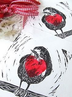 lino print robin with heart red breast