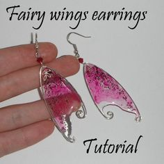 Get yourself some wire, glitter, and translucent liquid sculpey. You can make simple wings, or really go wild with detail!: