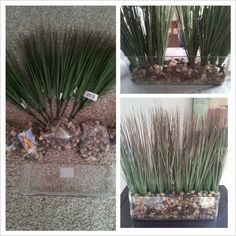 DIY home decor...Dollar Tree rocks and fake plants in an oblong glass vase from Michaels...less than $20!