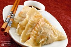 Shrimp and Pork Potstickers-Store-bought wonton wrappers and filling made from shrimp, pork, cabbage, garlic and soy sauce make a lighter, tender version of this Chinese takeout favorite.