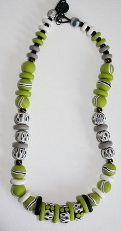 Polymer Clay Beads by Lyn Tremblay - Playing with canes and beads. Good colour combo.