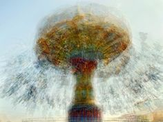 """""""the photographs were overlaid and refined to discover what becomes of the orbit. One may think they are looking at a single carousel in each image, but it is actually as many as several dozen separate shots of the same carousel, blended together — the carousel and its environment, in the round."""""""