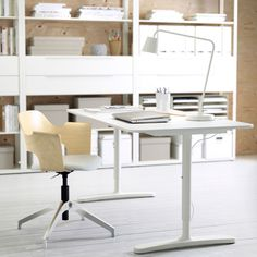IKEA BEKANT sit/stand adjustable-height desk in white , FJÄLLBERGET chair in birch, and FJÄLKINGE shelves in white