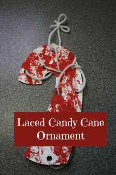 laced candy cane ornament & painting with golf balls (happy hooligans)  Paint white paper with red paint and golf balls (so much fun!)  Cut into candy cane shape.  Punch holes and lace with white yarn.