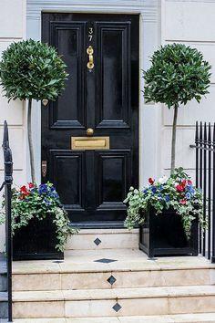 shiny black door, brimming planters & inlaid diamonds