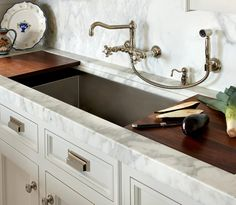 O'Brien Harris - kitchens - white shaker cabinets, calcutta marble countertops, marble slab backsplash, vintage faucets, vintage kitchen fau...