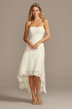 Choose your wedding shoes with extra-special care: crafted of substantial corded lace, this tea-length, high-low silhouette shows off a statement pair and makes kicking up your heels a dream. Casual Country Wedding, Country Wedding Dresses, Wedding Dress Styles, Bridal Dresses, Bridesmaid Gowns, Lace Dress With Sleeves, The Dress, Hi Low Wedding Dress, Wedding Shoes