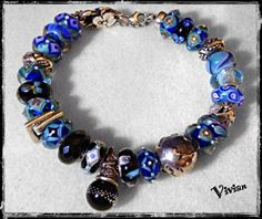 Black & Blues.  A stunning bracelet from a collector on Trollbeads Gallery Forum.  Join and enjoy the sites!