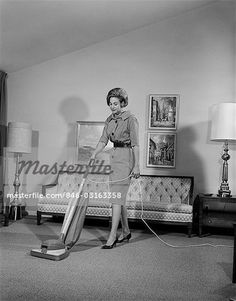 1960s WOMAN VACUUM HOUSEWORK CHORE HOUSEWIFE