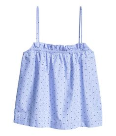 Blue/dotted. Short top in plumeti cotton with elastication at top and narrow shoulder straps.